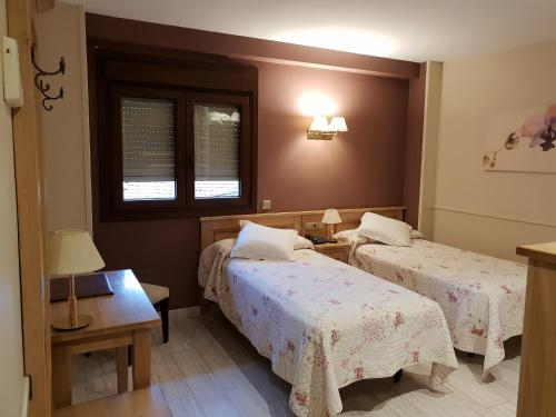 A bed or beds in a room at A Boira