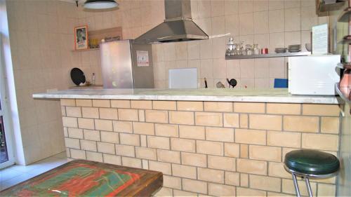 Кухня или мини-кухня в Гостевой Дом Верещагинский