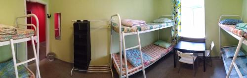 A bunk bed or bunk beds in a room at Хостел Дача на Ветеранов