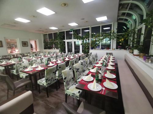 A restaurant or other place to eat at Pension & Restaurant TsingDao