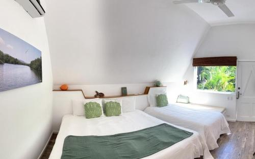 A bed or beds in a room at Punta Rucia Lodge