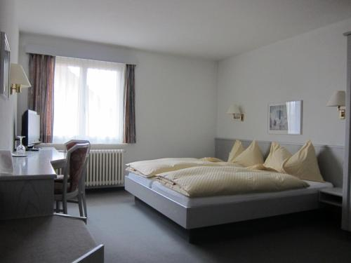 A bed or beds in a room at Landhotel Hirschen