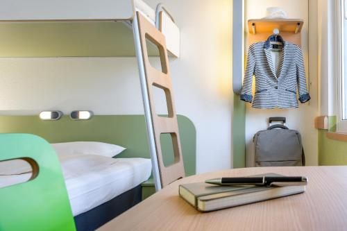 A bunk bed or bunk beds in a room at ibis budget Berlin Kurfürstendamm