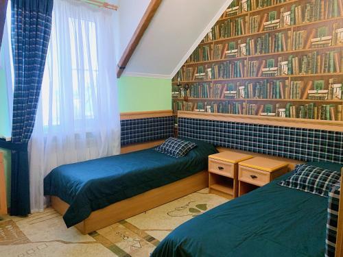 Кровать или кровати в номере Hotel Evropa