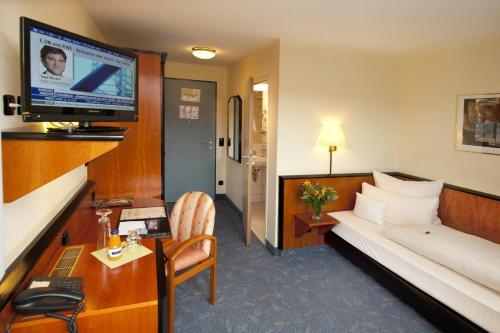 Ein Sitzbereich in der Unterkunft Advantage Appartements Hotel