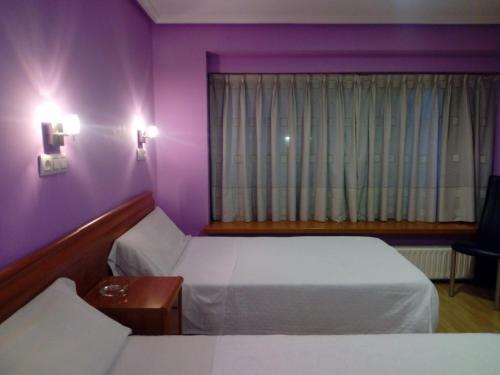 Cama o camas de una habitación en Hostal Álvarez