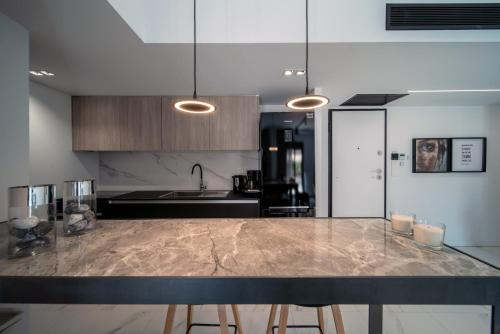 A kitchen or kitchenette at Heritage Boutique Apartments