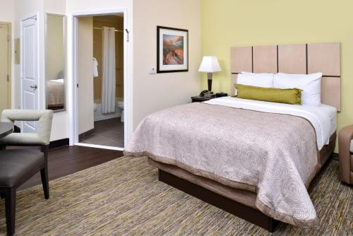 A bed or beds in a room at Candlewood Suites Kenedy