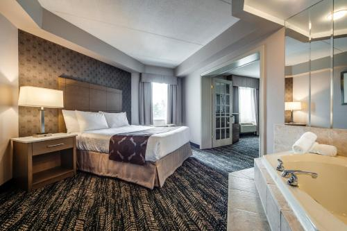 A bed or beds in a room at Monte Carlo Inn Brampton