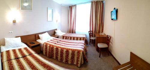 Кровать или кровати в номере Гостиница Елец