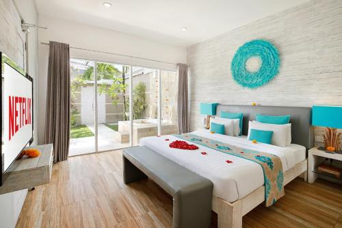 A bed or beds in a room at Bali Cosy Villa