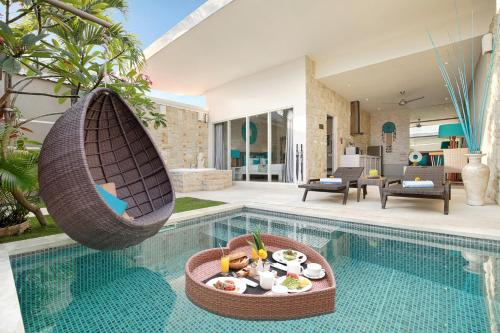 The swimming pool at or close to Bali Cosy Villa