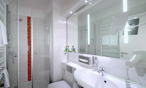 Ein Badezimmer in der Unterkunft Hotel Bavaria Superior