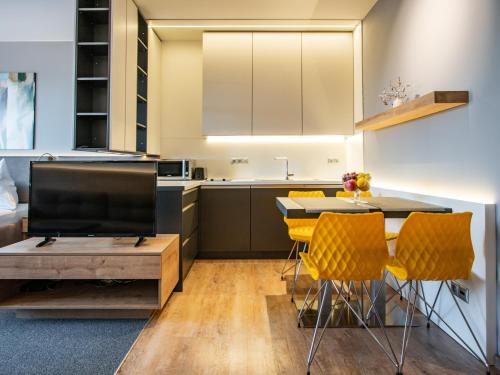 A kitchen or kitchenette at TATRA SUITES Luxury Studio A302
