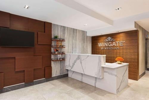 A television and/or entertainment centre at Wingate by Wyndham New York Midtown South/5th Ave
