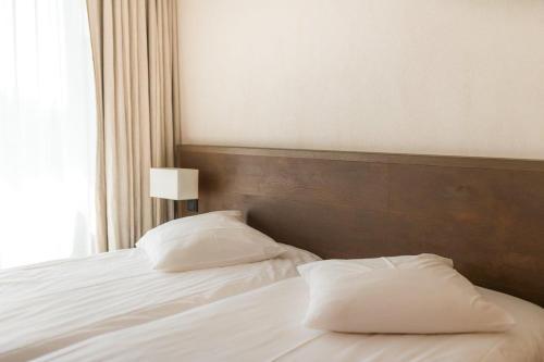 Letto o letti in una camera di La Gree Des Landes - Eco-Hotel-Spa Yves Rocher