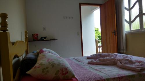 Cama ou camas em um quarto em Flat Terra do Sol