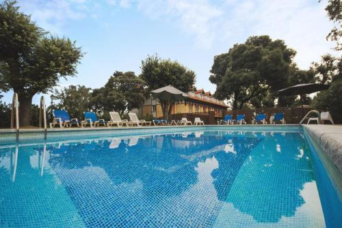 The swimming pool at or near Hotel Torres de Somo