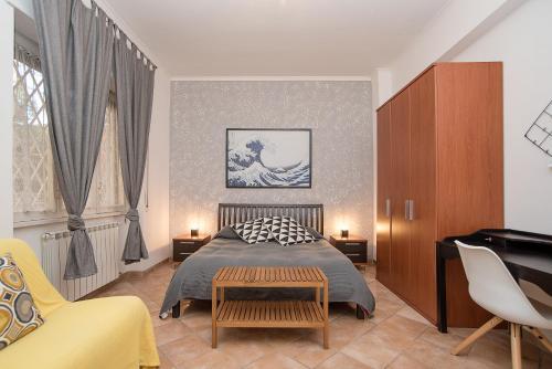 Un ou plusieurs lits dans un hébergement de l'établissement Rome All In Apartments