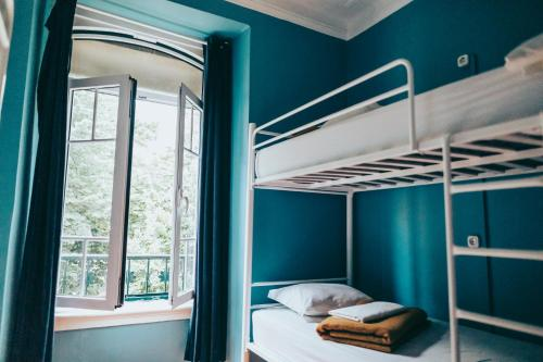 A bunk bed or bunk beds in a room at Urban Garden Hostel