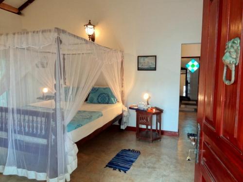 Кровать или кровати в номере French Lotus