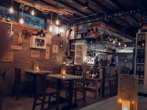A restaurant or other place to eat at Otium Boutique Room
