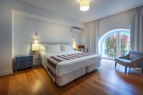 Cama o camas de una habitación en My Suite Lisbon Guest House – Principe Real