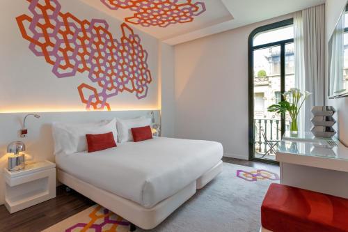 Un ou plusieurs lits dans un hébergement de l'établissement Room Mate Carla