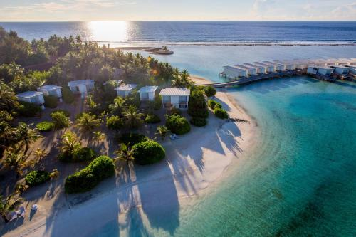 A bird's-eye view of Holiday Inn Resort Kandooma Maldives with 50% Off on Transfers