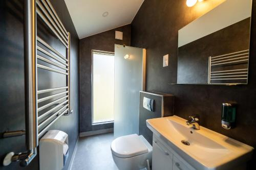 A bathroom at Welcome Holiday Home