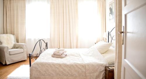 Ein Bett oder Betten in einem Zimmer der Unterkunft Großkandlerhaus