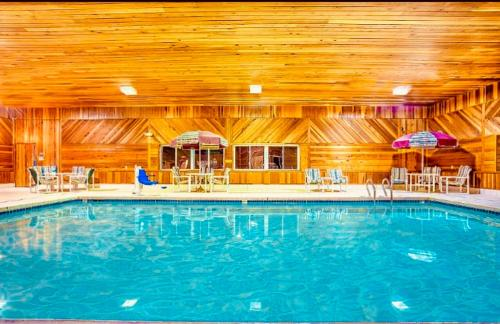 The swimming pool at or near Super 8 by Wyndham Osseo WI