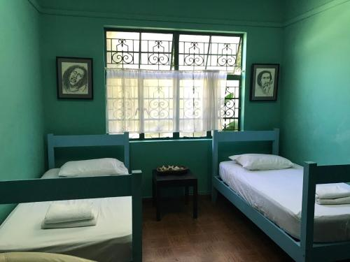 A bed or beds in a room at Backpackers Hostel