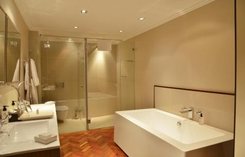 A bathroom at Cape Royale Luxury Suites