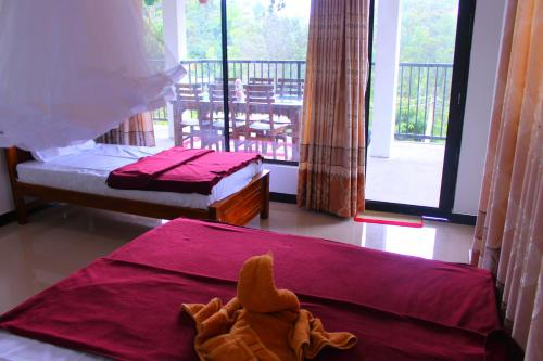 A bed or beds in a room at Thilini homestay