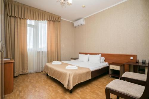 Кровать или кровати в номере Отель Экодом Фэмили