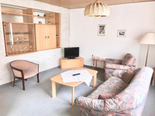 Ein Sitzbereich in der Unterkunft Hotel Recke