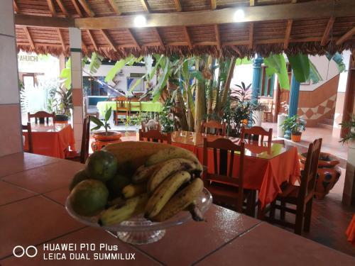 Un restaurante o sitio para comer en Hotel Pahuichi