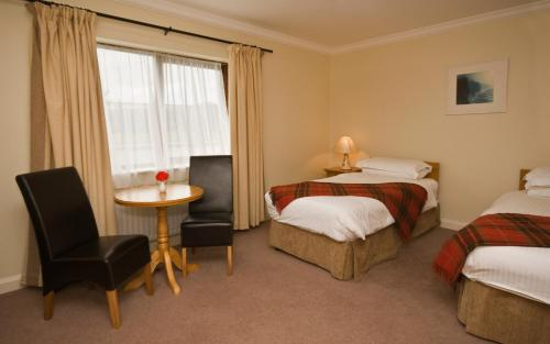 A bed or beds in a room at Renvyle House Hotel