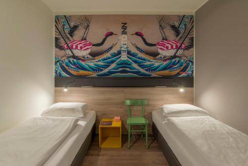 A bed or beds in a room at Bento Inn Munich