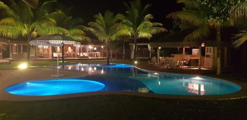 The swimming pool at or near Luxury Bungalows Praia do Espelho