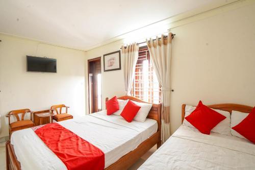 Giường trong phòng chung tại Windy River Homestay