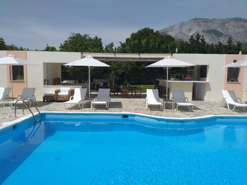 The swimming pool at or near Aphrodite Hotel & Suites