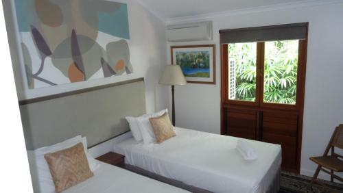 A bed or beds in a room at Shanee Prana