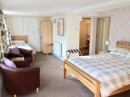 A bed or beds in a room at Netherby House