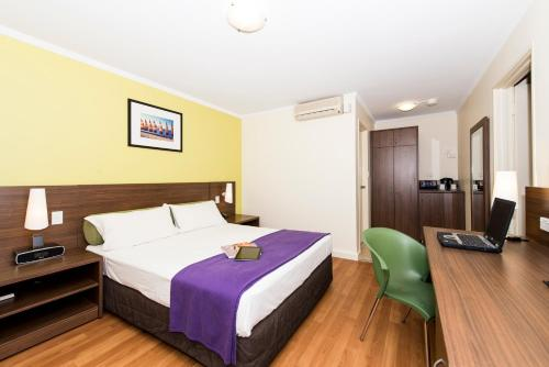 A bed or beds in a room at Ibis Styles Karratha