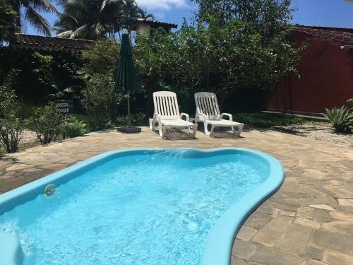 The swimming pool at or near Pousada Baía das Conchas