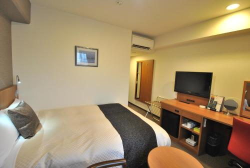 A television and/or entertainment centre at Hotel Mark-1 Tsukuba