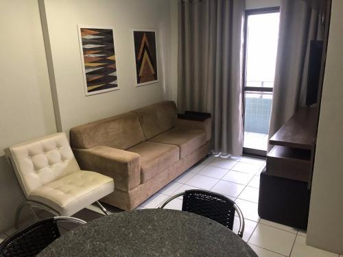 A seating area at Apt. para Família - Completo em Recife, Boa Viagem - 3 qts - p/ 6 pessoas - 300m da praia