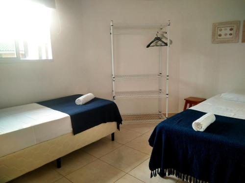 A bed or beds in a room at Condominio Villa Remanso